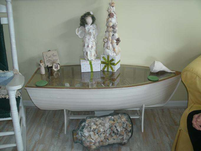 boat table with handmade ornaments made of shells