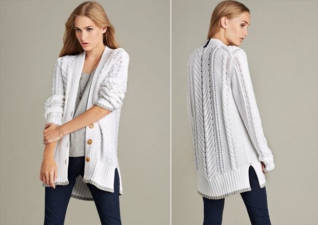 White luxurious cable cardigan in pima cotton features contrast details at placket and hem.