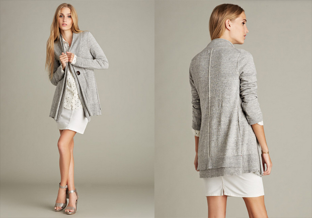 Gray cardigan with subtle slub texture features contrast seam detail, long sleeves, and an open front with leather button.